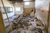 Ben Kleppinger/ben.kleppinger@amnews.com A bathroom wall is one that had been demolished recently on Monday.