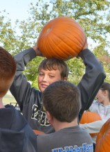 Robin Hart/robin.hart@amnews.com Ethan Milburn finds that resting his heavy pumpkin on his head it better than trying to carry it in his arms.