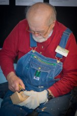 Photos by James Morris Guy Ingram, a community volunteer, works on one of his word carvings. Ingram does a wood-carving display most every year at the festival.