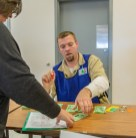 Ben Kleppinger/ben.kleppinger@amnews.com Northpoint inmate Michael Reynolds collects $25 from a participant for food.