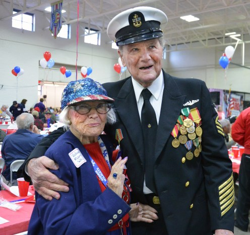 Photo by Robin Hart/robin.hart@amnews.com Martha Whiles, of Stanford, poses for a photo with Norman Walker of Danville during the annual Heritage Hospice Veterans Day lunch on Monday. Whiles is a volunteer for the annual event to honor veterans. Walker joined the Navy at age 17 in 1942.