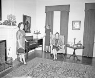 "The Ephraim McDowell House was decorated by members of the Garden Club of Danville for their first ""Green Tea"" in 1964. Shown in the parlor with their holiday arrangements are, from left, Mrs. James F. Clay, Mrs. Dudley Bryant, and Mrs. O.L. May.Reference Librarian Mary Girard, BCPL, from Advocate-Messenger articles."