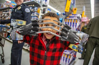 Ben Kleppinger/ben.kleppinger@amnews.com 6-year-old Hogsett student Tristan shows off a pair of Black Panther claws he was getting.