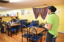 Israel checks on some late lunch customers at La Hacienda.
