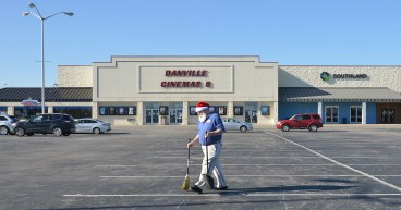Robin Hart/robin.hart@amnews.com Part of Robin Strey's morning routine as manager when opening the Danville Cinemas 8 is patroling the parking lot for trash.