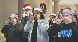 """Photo by Robin Hart/robin.hart@amnews.com Members of Danville High School's American Sign Language I and II classes sign the song """"Santa Claus is Coming to Town"""" during the chorus, """"You better not cry, you better not pout."""" The class performed Christmas songs with students in the Kentucky School for the Deaf Signing Choir at McDowell Place on Tuesday."""