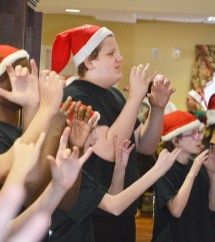 Photo by Robin Hart/robin.hart@amnews.com KSD student Caleb Vickery sings a Christmas song using American Sign Language at McDowell Place of Danville on Tuesday afternoon.