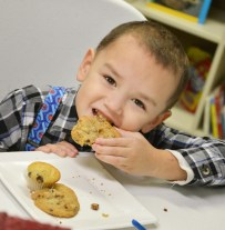 Photos by Robin Hart Leo Price enjoys cookies during the open house on Thursday at the Housing Authority's Community Service Center.