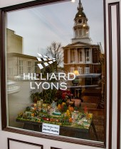 Ben Kleppinger/ben.kleppinger@amnews.com The Boyle County Courthouse is reflected in the Hilliard Lyons window where one of John Bowling's dioramas sits on display.