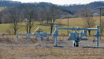 Natural gas mainlines belonging to Texas Eastern, Tennessee Gas and Atmos Energy converge at a mainline valve station on Alum Springs Cross Pike. If a mainline emergency should occur somewhere in the area, natural gas can be shut off from this location. Photo by Robin Hart