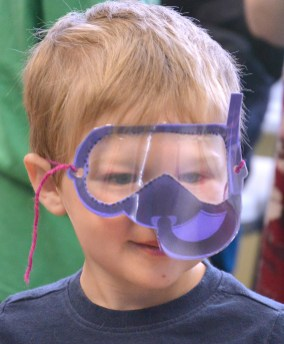 Jase Daugherty wears a construction paper scuba mask during an activity where students were learning about the ocean and creatures that swim there.Photo by Robin Hart.