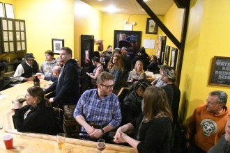 Patrons filled the small brew pub until closing Sunday night. Photo by John Scarpa .