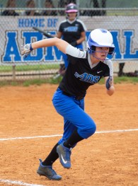 Samantha Bottom runs to first after hitting an infield grounder. Photo by Ben Kleppinger)