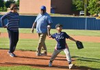 Kyren Burdette throws out the first pitch on Troy Trumbo Day. Kyren is the cousin of the late Troy Trumbo; standing behin Kyren are Troy's parent's Doris and Robert. Photo by Robin Hart