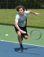 Danville's Seth Brunner returns a shot during a doubles match against Danville in the 12th Regional Boys tennis tournament on Friday. (Photo by Robin Hart)