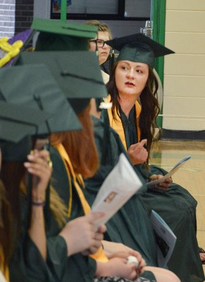 Parrie Herring peeks behind the row of KSD graduates before the ceremony began.(Photo by Robin Hart)