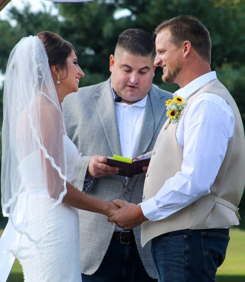 Bryan Montgomery officiates the wedding of Hannah and David Moore's wedding. Photo submitted