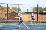 Jenna Akers, front, of Danville moves in to return a shot as Lara Akers looks on during the girls doubles final Monday at the 12th Region Tournament. The sisters won in straight sets to capture their second consecutive regional title. (Photo by Mike Marsee)