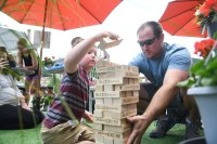 Weston, age 5, and Charlie Long set up a Jenga set at the pop up park in downtown Danville onSaturday. (Photo by John Scarpa)