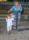 """Twins Nick (front) and Charlie Little, 3, play in a sheep pen while visiting the sheep show with their grandmother, Lana Little. """"They love sheep,"""" Lana said. (Photo by Ben Kleppinger)"""