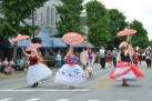 Several ladies with hoop skirts and parasols have fun twirling down Main Street while leading the March Madness Marching Band on Saturday. (Photos by Robin )