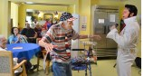 Ernie Blanchet dances with Elvis, also known as Barry Lockard, during Blanchet's 106th birthday celebration Monday afternoon at Charleston Assisted Living facility in Danvile. (Photo by Robin Hart)