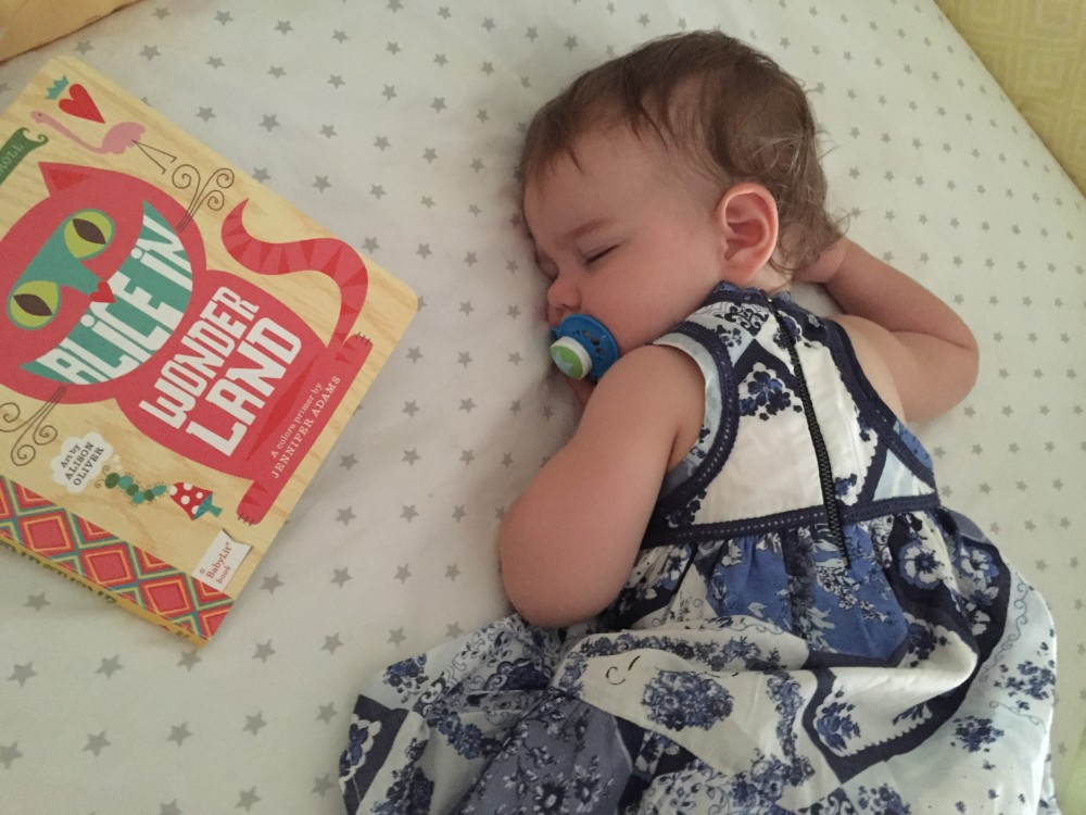 emmy naps with her BabyLit.