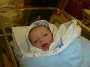 baby boy in bassinet
