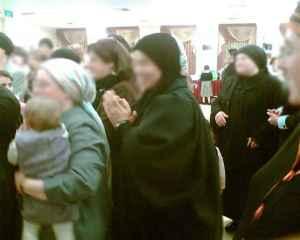woman at Jerusalem wedding wears shal (cloak)