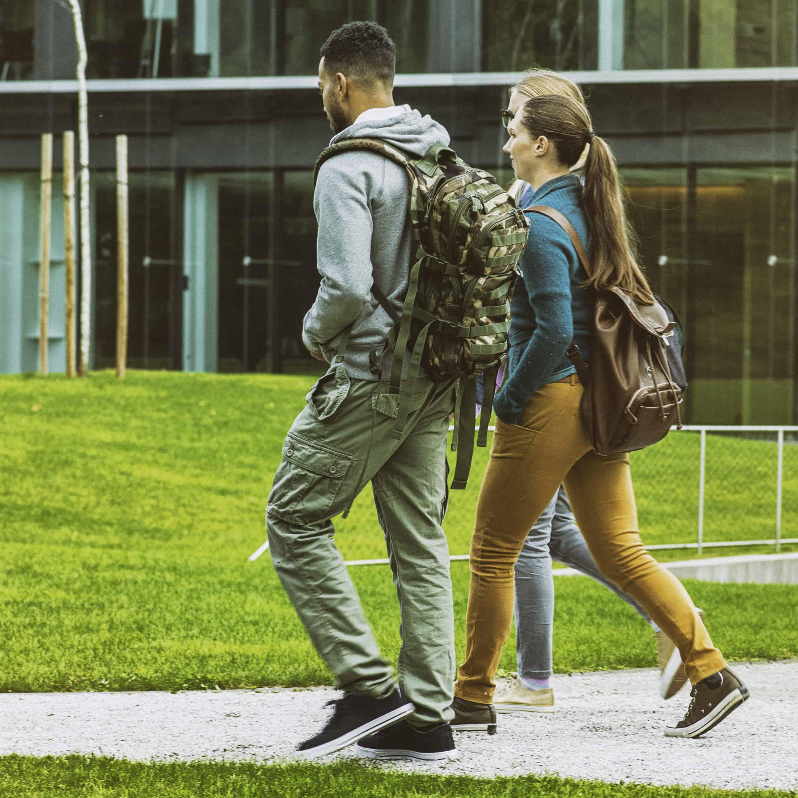 higher ed students walking