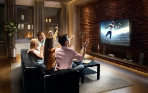Family watching Football Game on TV