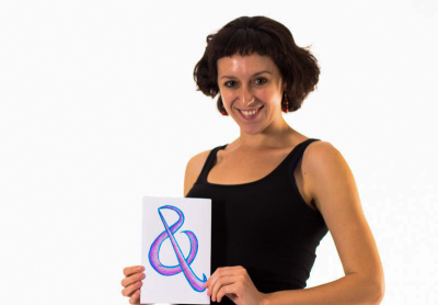 Elizabeth Nonemaker holds up her beautiful purple and blue Ampersand