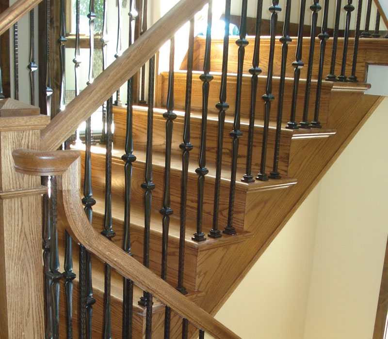 Wood Spiral And Curve Staircase Design Amron Stair Works | Wood Handrail With Iron Balusters | Ash Gray | Ole Iron | Upstairs | Wrought Iron | Low Profile
