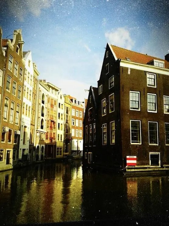 Oudezijds kolk and its buildings in Amsterdam's Red Light District.