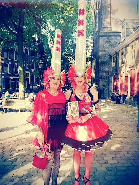 Two transvestites at The Old Church Square, during the Open Day in Amsterdam's Red Light District.