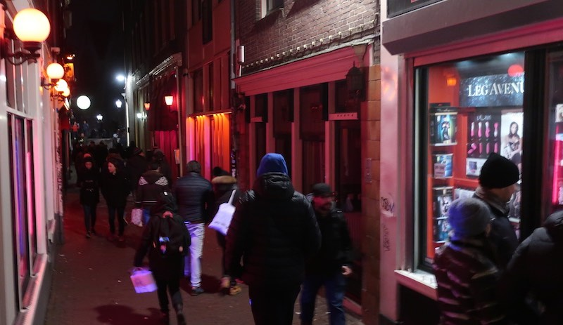 Dutch prostitute works in Amsterdam Red Light District streets
