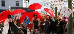 Sex Worker Exhibition Amsterdam united under a red umbrella
