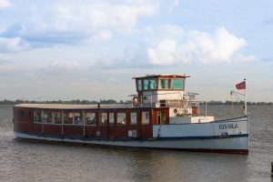 Saloon boat elvira sails as a ferry from amsterdam ijburg to amsterdam castle muiderslot and fortress island pampus. The boats can also be booked for events
