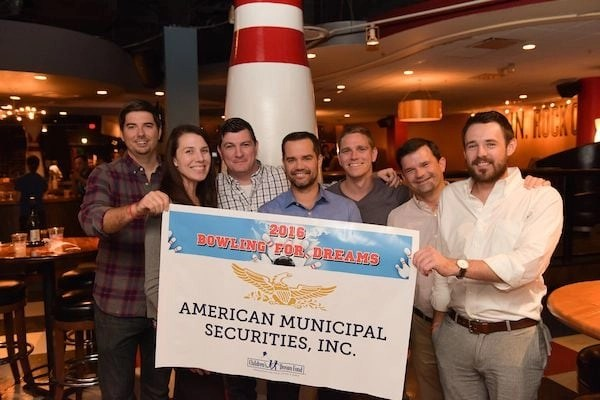 Amuni Team at the bowling alley for a Charity event