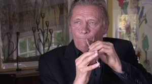 Danish musician Peter Bastian plays a straw flute