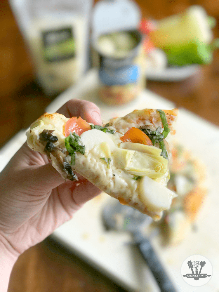 This rustic homemade pizza, loaded with yummy veggies like hearts of palm, sweet peppers, tender small artichoke hearts, fresh tomatoes, is the perfect dinner for summer!