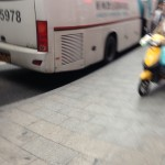 Photo of a moped about to run me over on a sidewalk. I am bad at dodging and taking pics at the same time.