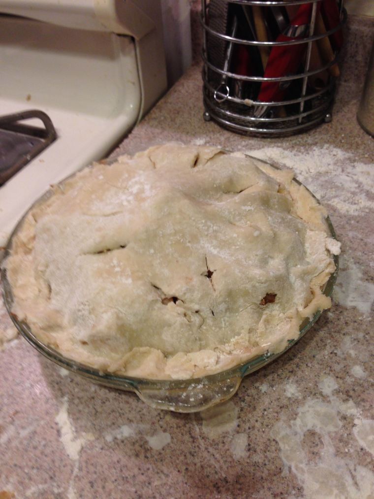 Unbaked pie with lid.