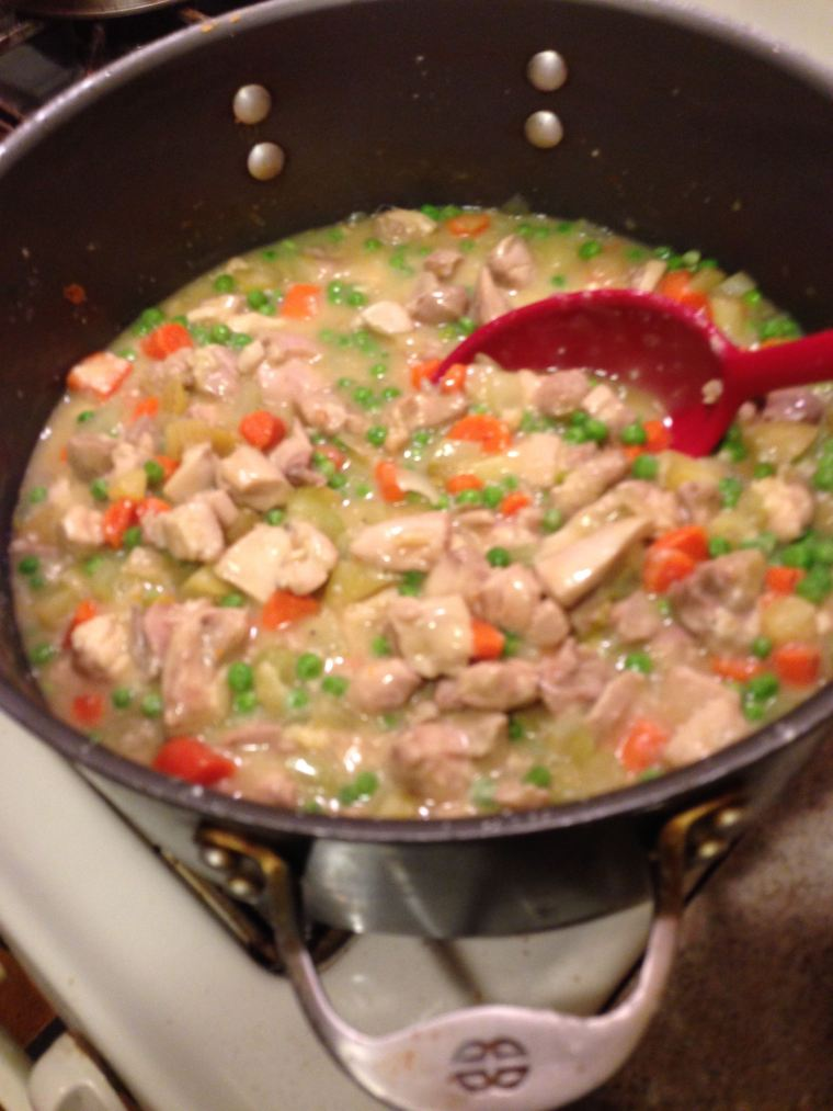 Pot pie filling simmering on the stove.