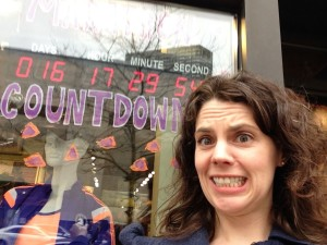 Freaking out with the marathon countdown clock at Marathon Sports.
