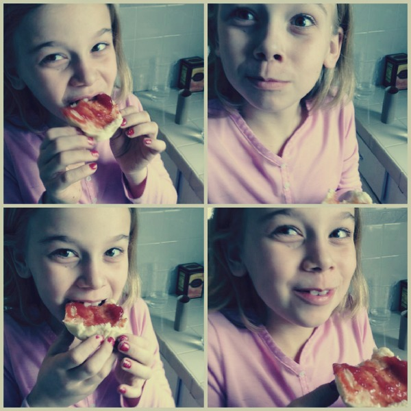 girl eating english muffin and jam