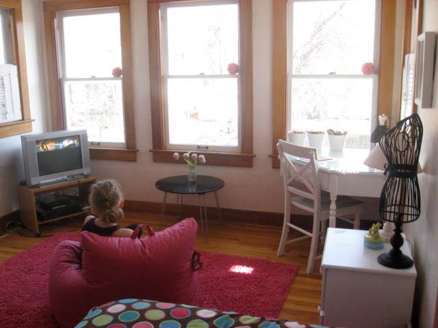 Girl watching tv in room