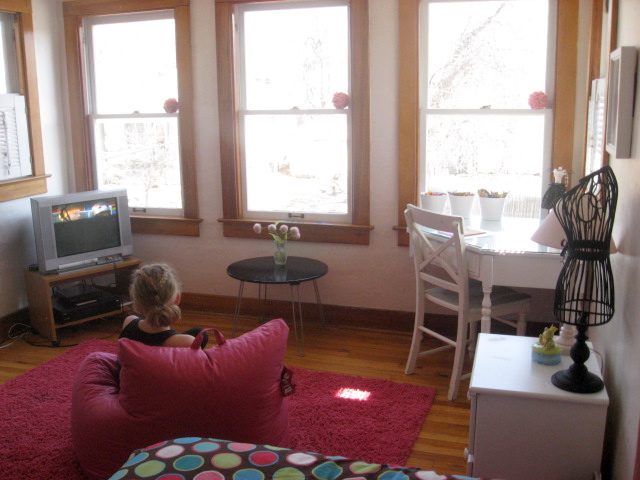 Girl watching tv in room