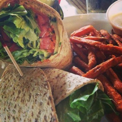 Veggie wrap and sweet potato fries with a lemon ginger aioli dip.