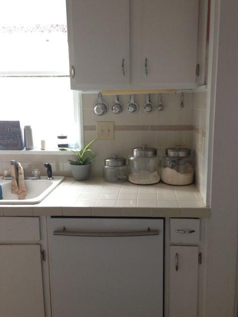 White organized kitchen and sink